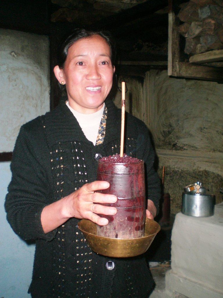 How the Chang beer is served. Homestay Lady Serving Millet Beer
