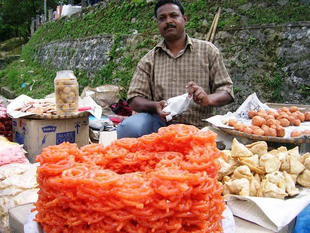 Indian Sweets Salesman - Roadside hawker selling jalebis in West Sikkim